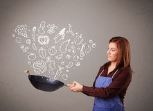 Young woman cooking vegetables Royalty Free Stock Photography