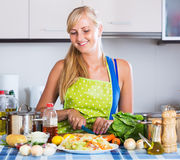 Young woman cooking vegetables Stock Images