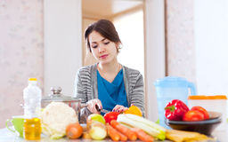 Young woman cooking veggie food Royalty Free Stock Images