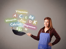 Young woman cooking vitamins and minerals. Pretty young woman cooking vitamins and minerals Royalty Free Stock Photography
