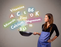 Young woman cooking vitamins and minerals Royalty Free Stock Photo