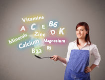 Young woman cooking vitamins and minerals Stock Image