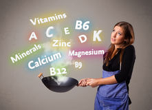 Young woman cooking vitamins and minerals Stock Photo