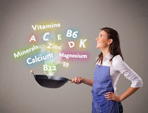 Young woman cooking vitamins and minerals Stock Images