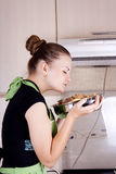 Young woman cooks dinner. In the kitchen Stock Photo