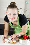 Young woman cooks dinner. In the kitchen Stock Photos