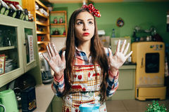 Young woman cooks in the kitchen Royalty Free Stock Images