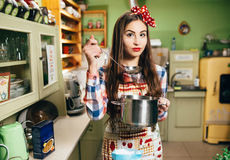 Young woman cooks in the kitchen Royalty Free Stock Photography