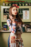 Young woman cooks in the kitchen Stock Photography