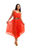 Young woman in coral dress Royalty Free Stock Photography