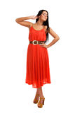 Young woman in coral dress Stock Photo