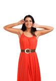 Young woman in coral dress Royalty Free Stock Image