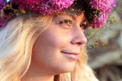 Young woman in corn haystack with wreath Royalty Free Stock Photo