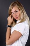 Young woman correcting hairs Royalty Free Stock Photos