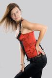 Young woman in corset Stock Images