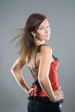 Young woman in corset Stock Image