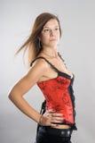 Young woman in corset Stock Photos