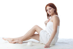 Young woman with cosmetic cream Royalty Free Stock Image