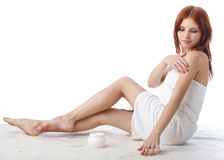 Young woman with cosmetic cream Royalty Free Stock Photography