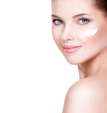 Young woman with cosmetic cream on a clean fresh face. Royalty Free Stock Photos