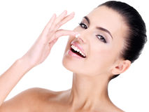 Young woman with cosmetic cream on face Royalty Free Stock Photography
