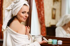 Young woman with cosmetic cream. Stock Image