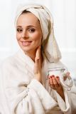 Young woman with cosmetic cream. Royalty Free Stock Photography