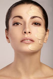 Young woman with cosmetic foundation on a skin Stock Photos