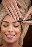 Young woman on cosmetic, make up treatment Stock Photos