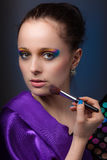 Young woman with cosmetic palette. Royalty Free Stock Image
