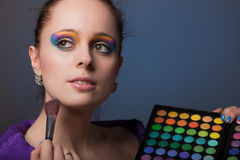 Young woman with cosmetic palette. Stock Photography