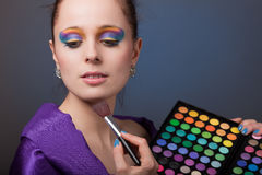 Young woman with cosmetic palette. Stock Images