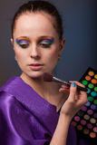 Young woman with cosmetic palette. Stock Image