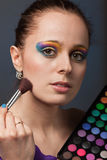 Young woman with cosmetic palette. Royalty Free Stock Images