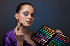Young woman with cosmetic palette. Stock Photos