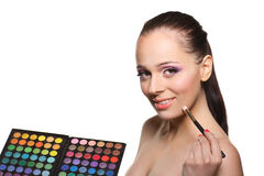 Young woman with cosmetic palette. Royalty Free Stock Photo