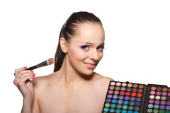 Young woman with cosmetic palette. Stock Photo