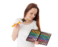 Young woman with cosmetic palette and paintbrush. Royalty Free Stock Photo