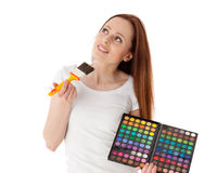 Young woman with cosmetic palette and paintbrush. Royalty Free Stock Photography