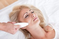 Young Woman During Cosmetic Treatment Royalty Free Stock Image