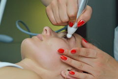 Young woman during cosmetic treatment Stock Photos