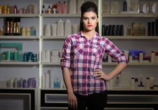 Young woman in cosmetics shop Stock Photography