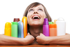 Young woman with cosmetics Stock Photography
