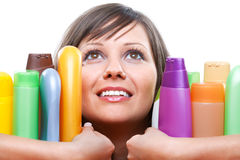 Young woman with cosmetics Stock Photo