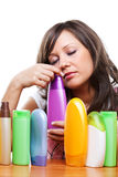 Young woman with cosmetics Stock Images