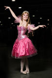Young woman cosplayer wearing pink dress Stock Image