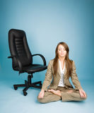 Young woman in costume sitting in lotus pose Stock Images