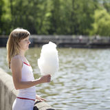 Young woman with cotton candy in the park Stock Image