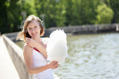Young woman with cotton candy in the park Royalty Free Stock Images