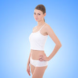 Young woman in cotton underwear over blue Stock Images